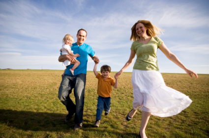 Happy Family in a grassy field