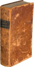 Old brown, first edition of The Book of Mormon, scuffed and worn